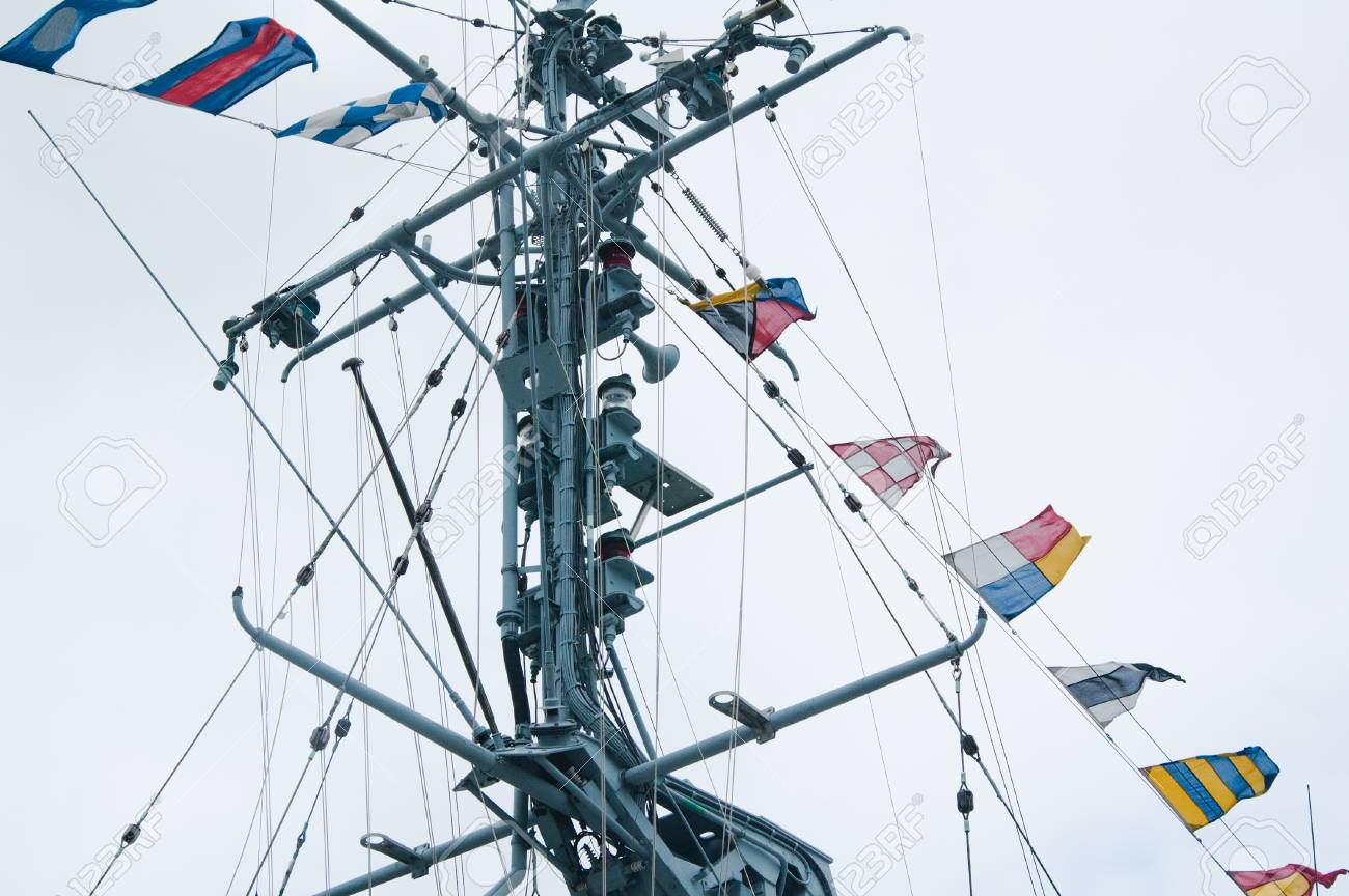Mast of the military ship and alarm flags Stock Photo - 13606318