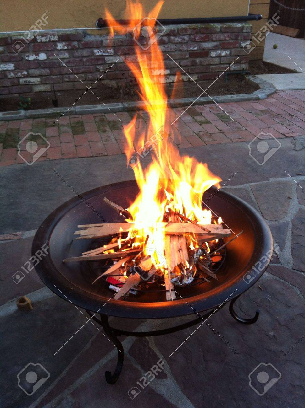 backyard fire pit wit tall flames stock photo picture and royalty