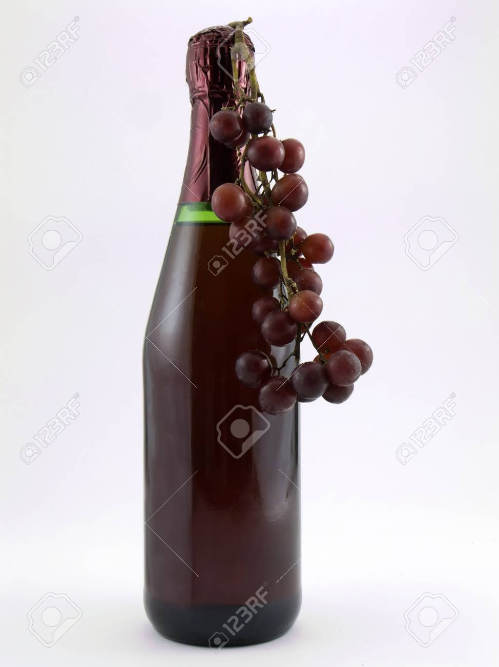 Photo of a wine bottle with red grapes hanging from it Stock Photo - 699956