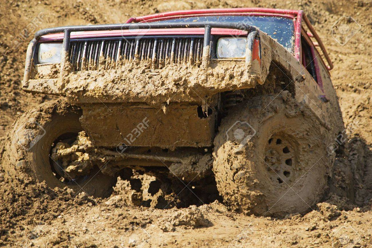 SUV overcomes steep muddy slope All potential trademarks are removed - 20302473