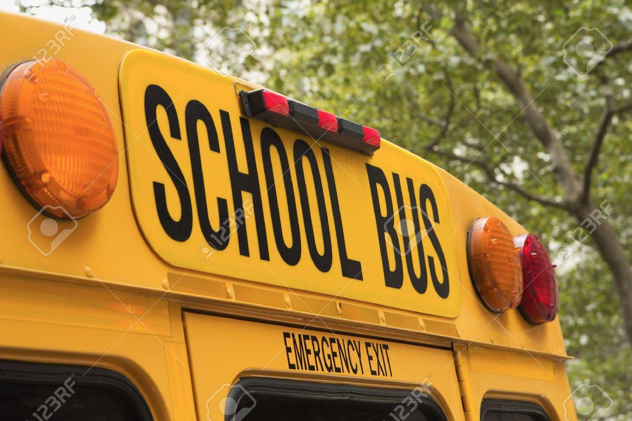 Yellow back of school bus with a sign - 21636623