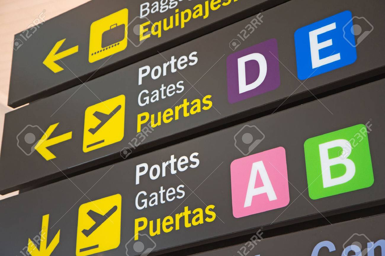 Airport Signs in English and Spanish language. - 32645884
