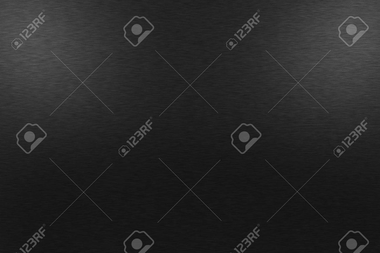 Pattern of brushed black metal background. Subdued light is at the top left and right side image. - 39721492