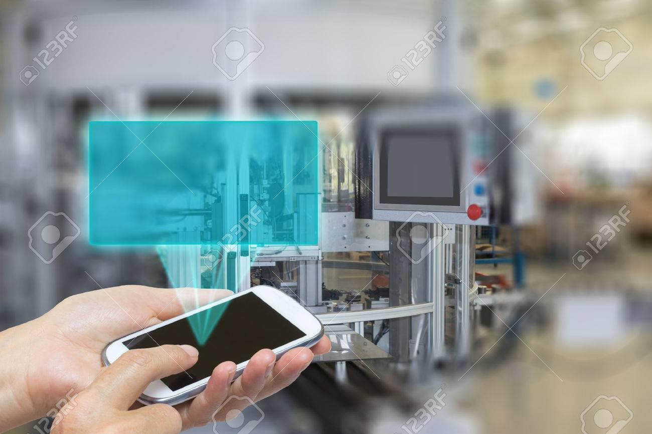 Female is using the smart phone Blank transparent rectangle radiates from the screen smart phone. The rectangle is ready for your text. The automatic production line is in the background. The edges of the pictures are deliberately blurred. - 44229957