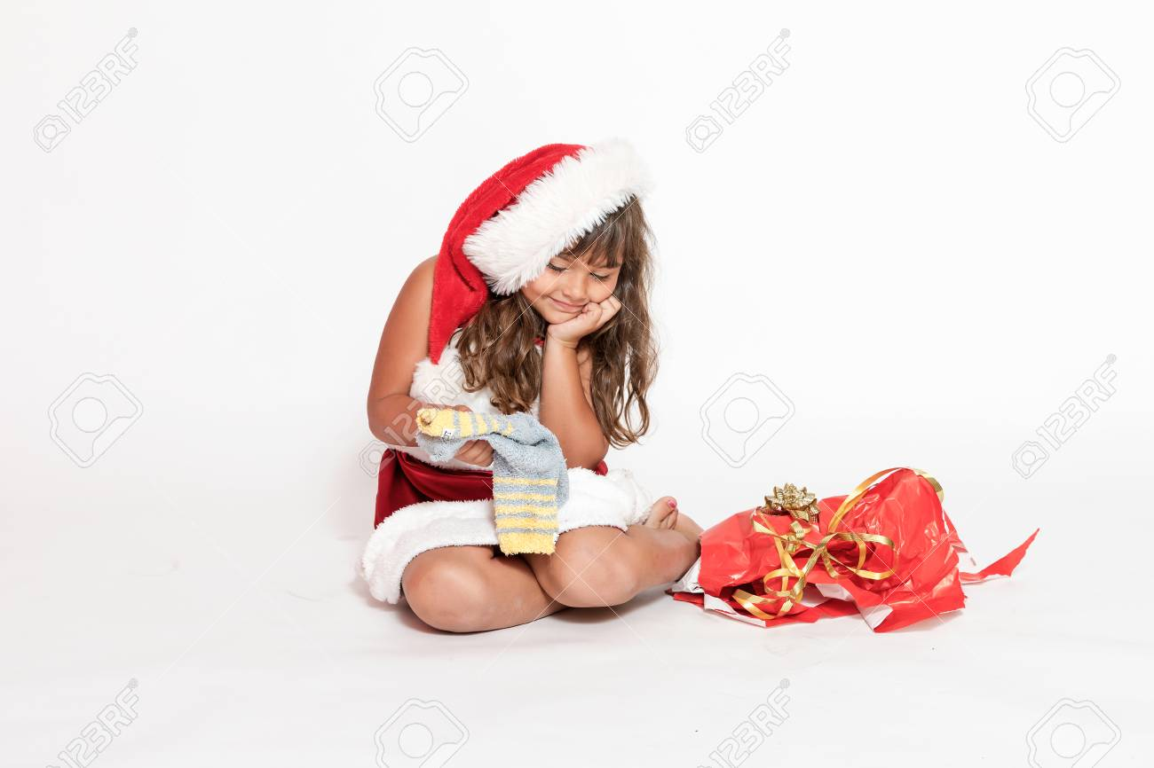 Smiling Little Girl In Santa Claus Costume Is Looking At An ...