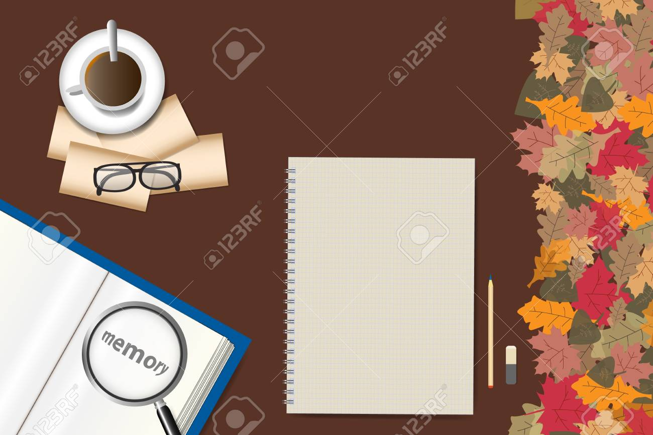 Top view of the table with blank paper ready for your text, open