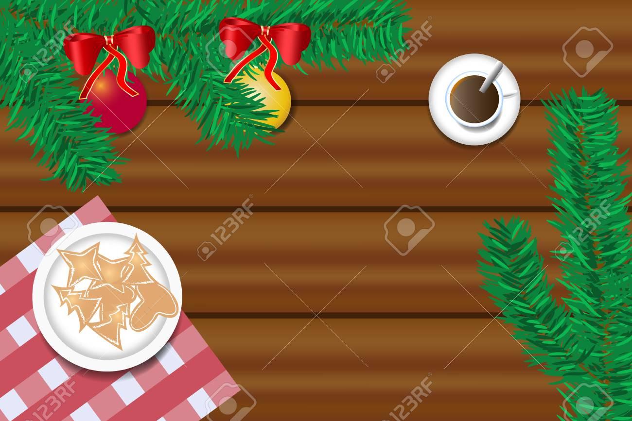 Vue de dessus du bureau en bois avec une branche de sapin de noël