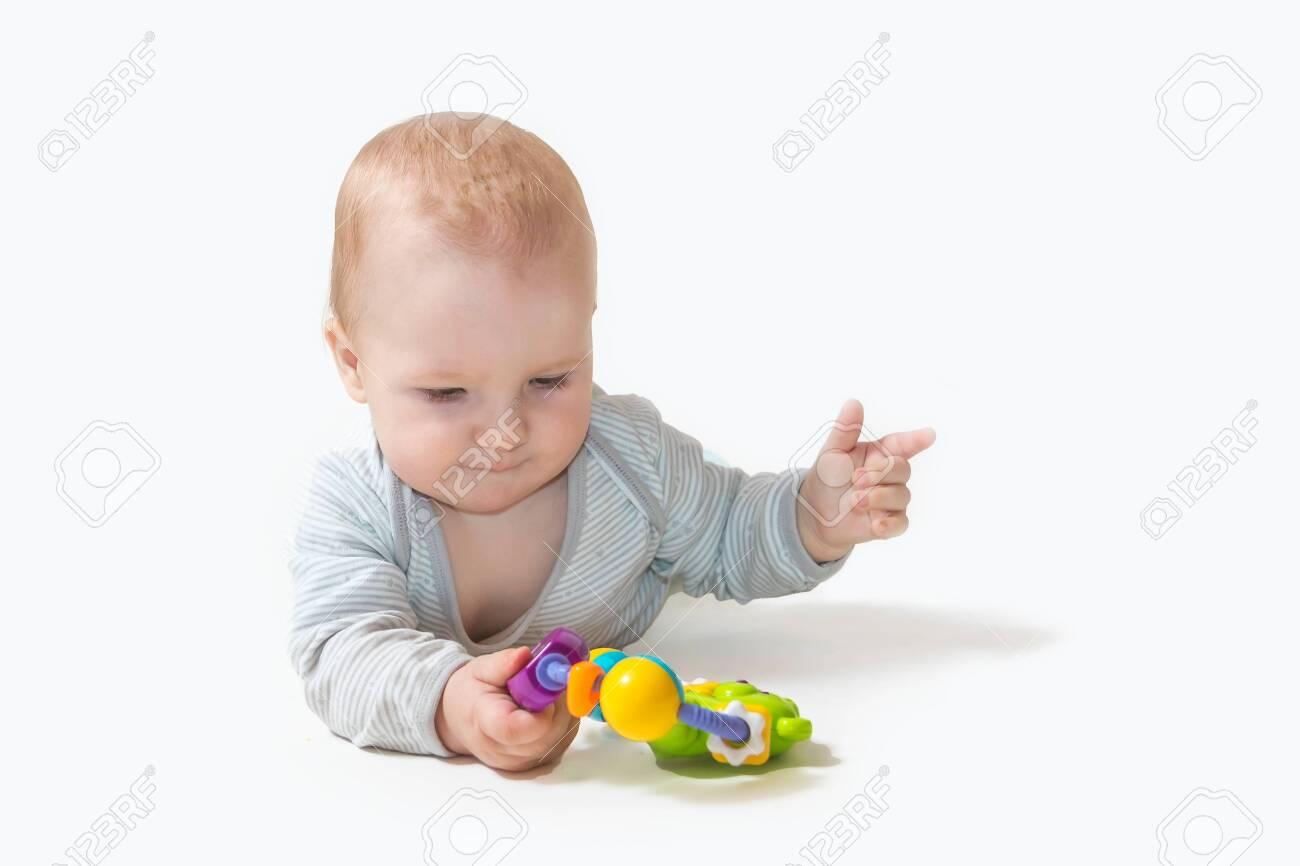 """Baby boy is playing with toy showing """"number two"""" by his fingers. All potential trademarks are removed. - 138663732"""