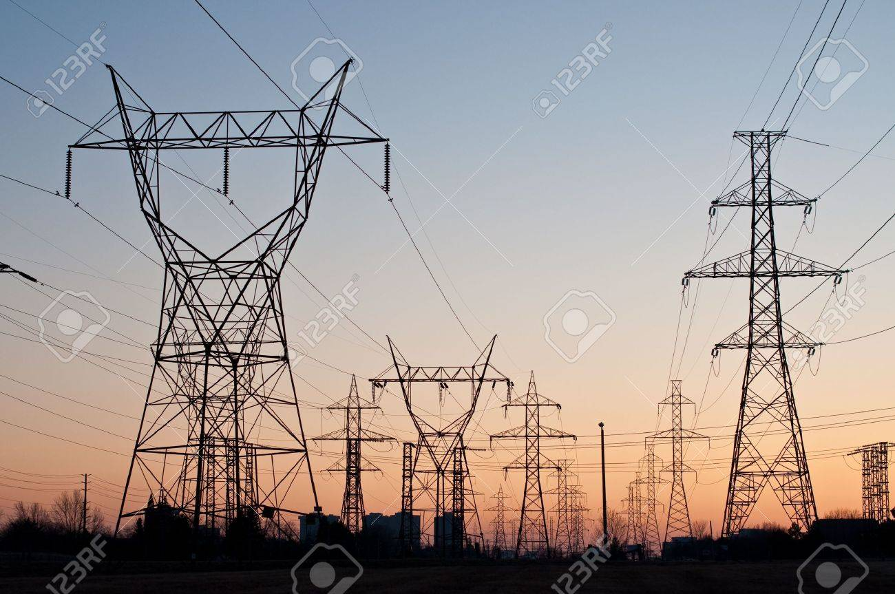 Electrical Transmission Towers (Electricity Pylons) at Sunset Stock Photo - 7823431