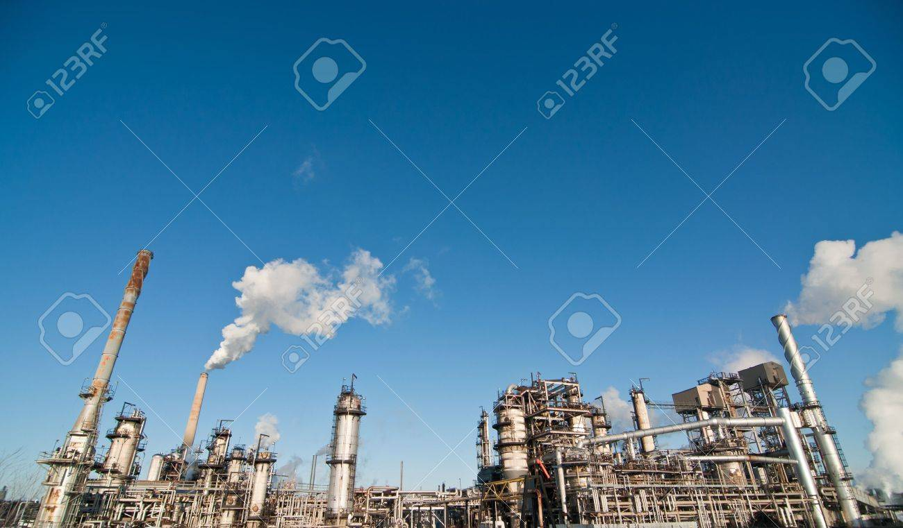 A petrochemical refinery plant with pipes and cooling towers. Stock Photo - 8720600