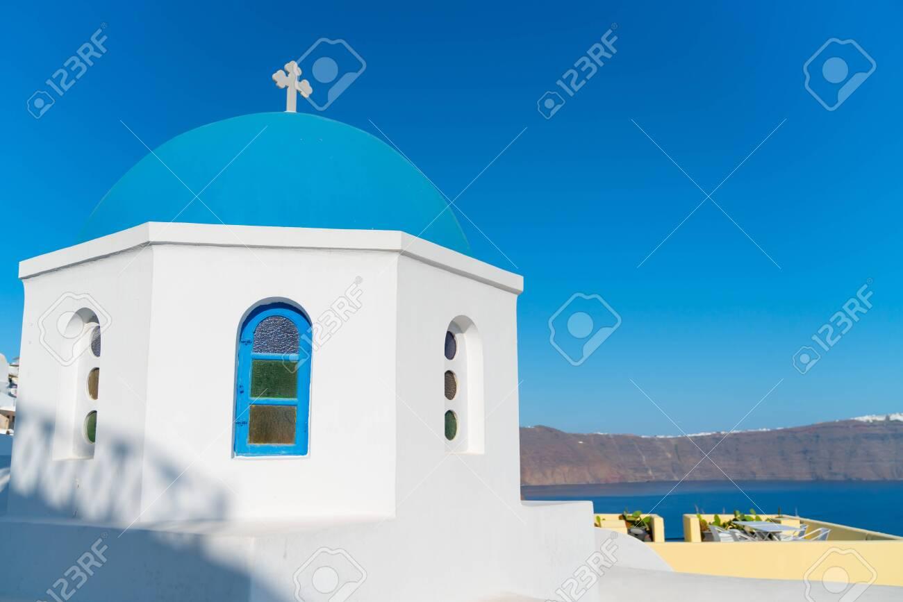 Characteristic blue dome of small Greek Orthodox church on island of Santorini. - 135011100
