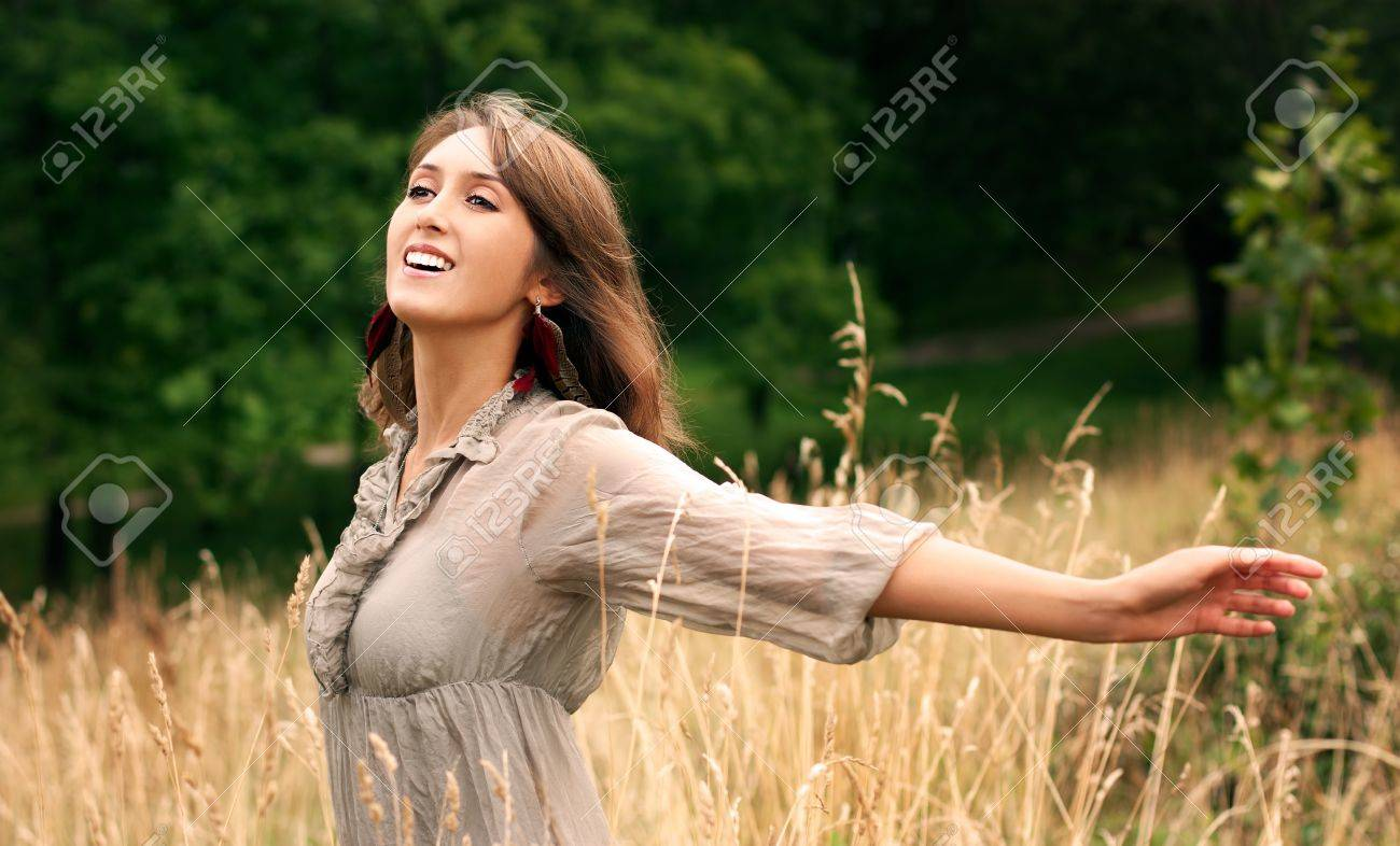 Beautiful Young Woman on Green Nature Background Stock Photo - 15100891