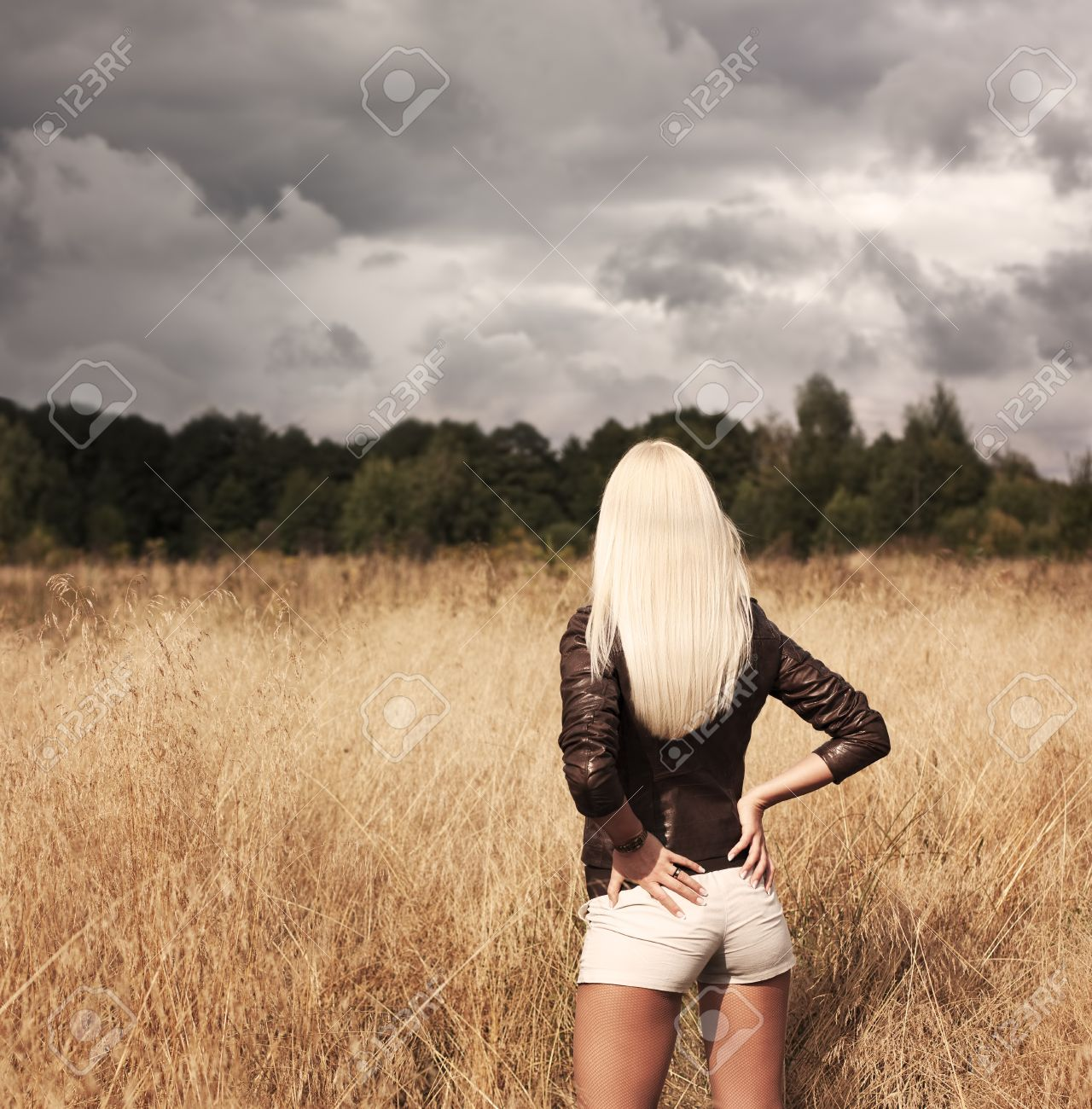 Sexy Blonde Woman Standing at the Field Stock Photo - 15147736