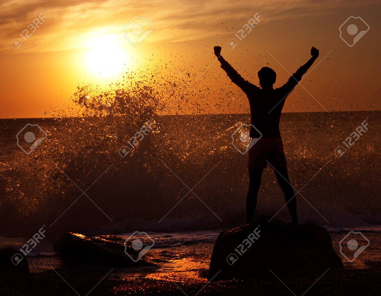 Silhouette of Man with Raised Hands at Stormy Sea  Freedom Concept Stock Photo - 15886965