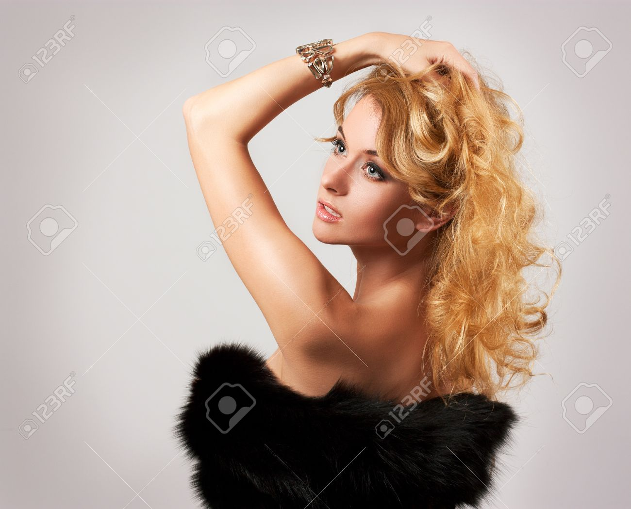 Portrait of Stylish Woman in Fur against Grey Background Stock Photo - 16969583
