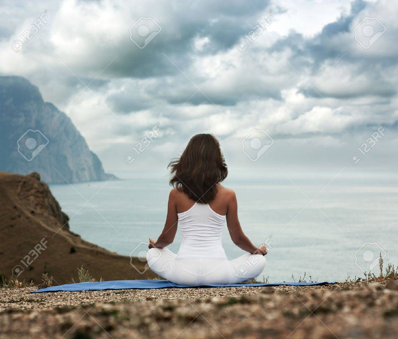 Young Woman in Lotus Position near the Ocean  Rear View Stock Photo - 17413964