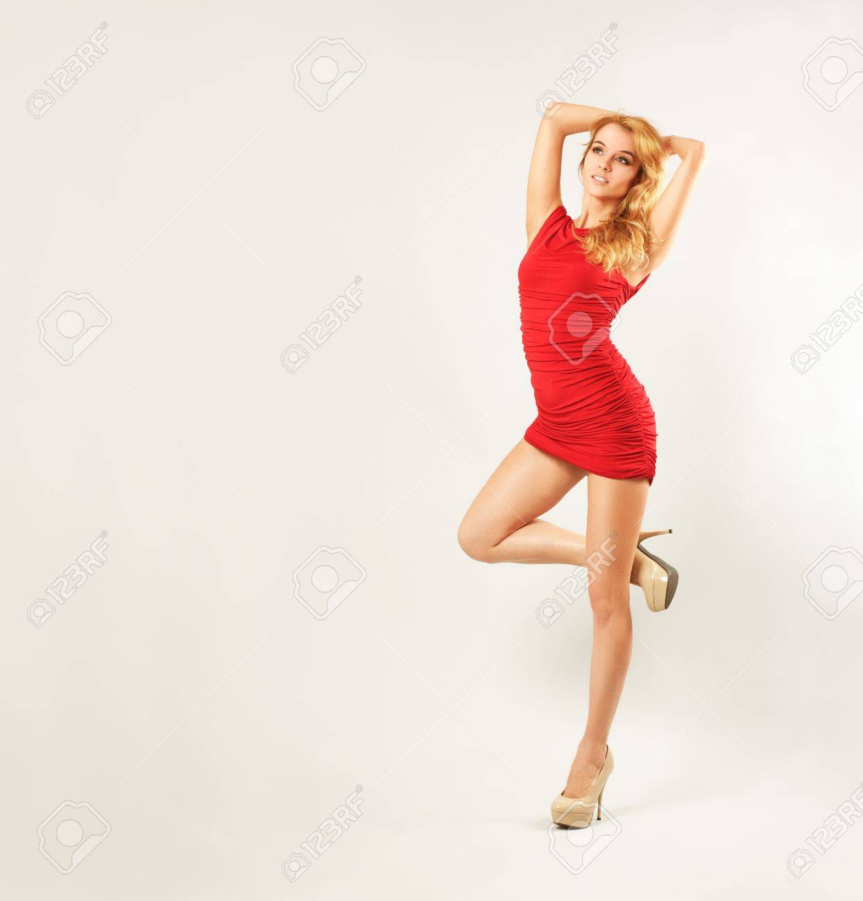 Full Length Portrait of a Sexy Blonde Woman in Red Fashion Dress Stock Photo - 17564214