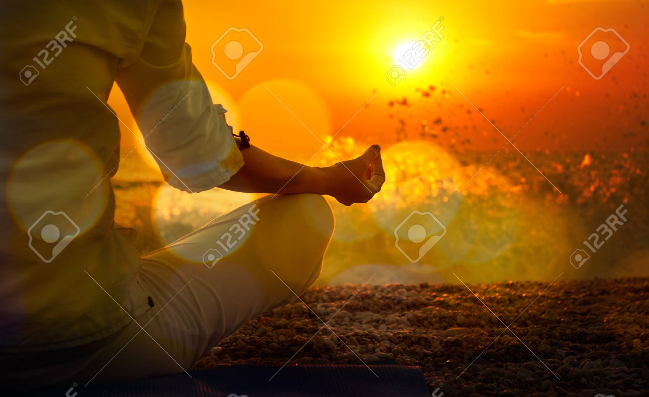 Woman Practicing Yoga by the Sea at Sunset. Beautiful Toned Photo with Golden Bokeh. Healthy Lifestyle Concept. - 28613180
