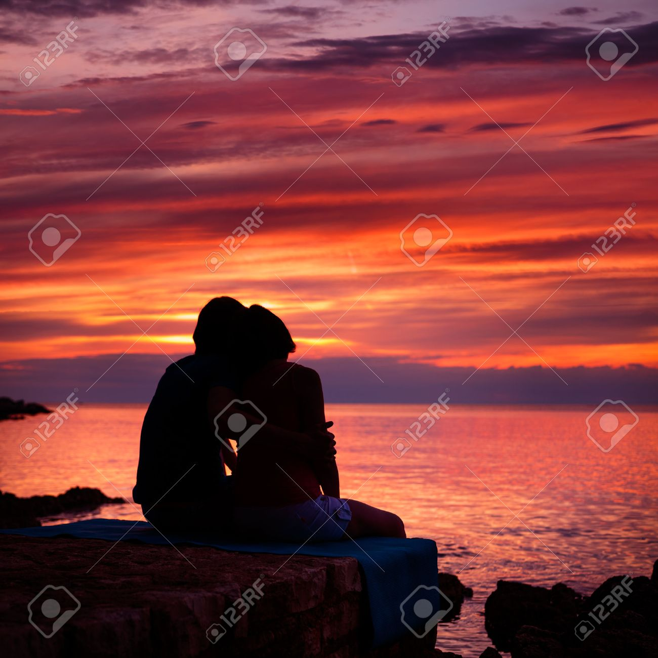 Silhouette of Romantic Couple Embracing and Watching Sea Sunset. Summer Nature Background. Copy Space. Love and Travel Concept. - 35751494