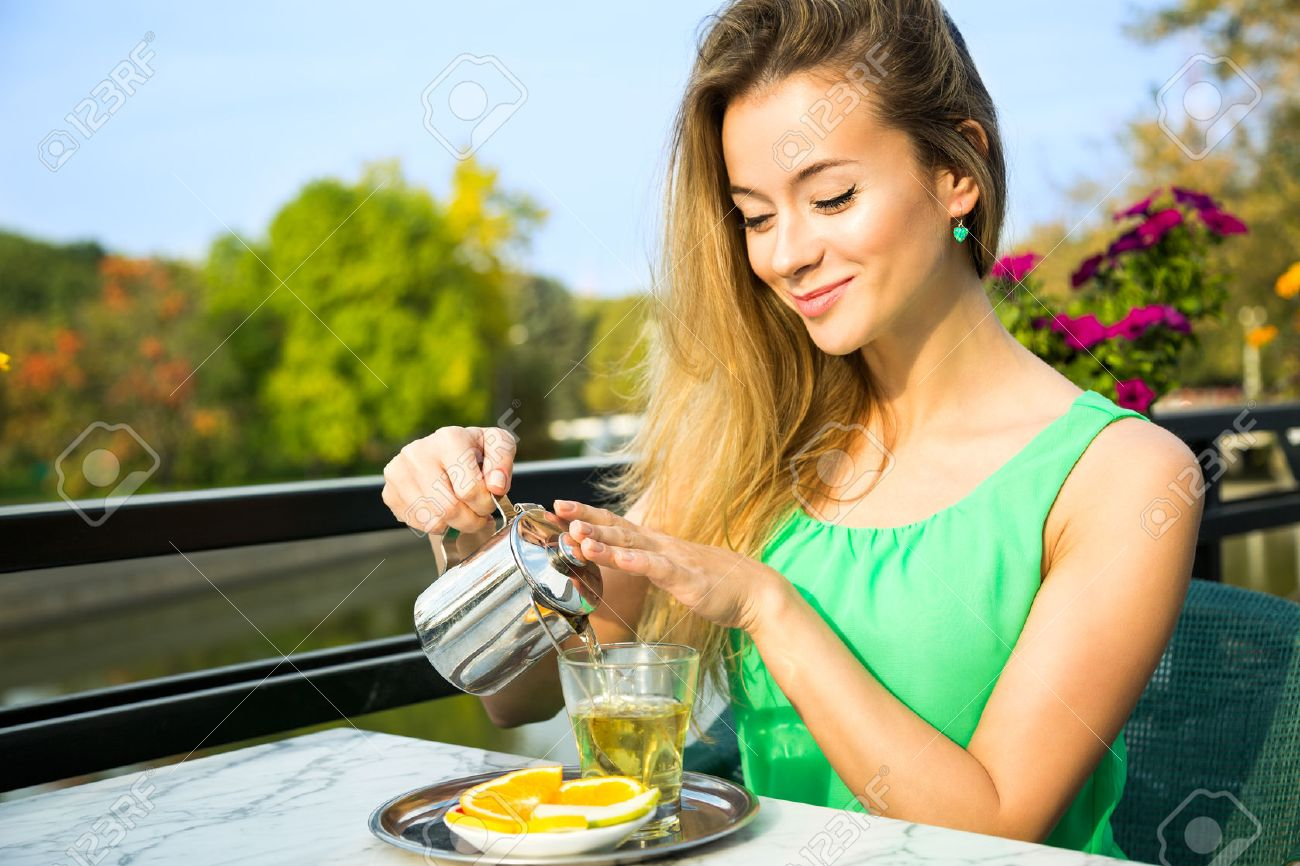 Happy Smiling Woman Making Green Tea Outdoors. Summer Background. Healthy Eating Concept. Shallow Depth of Field. - 39206968