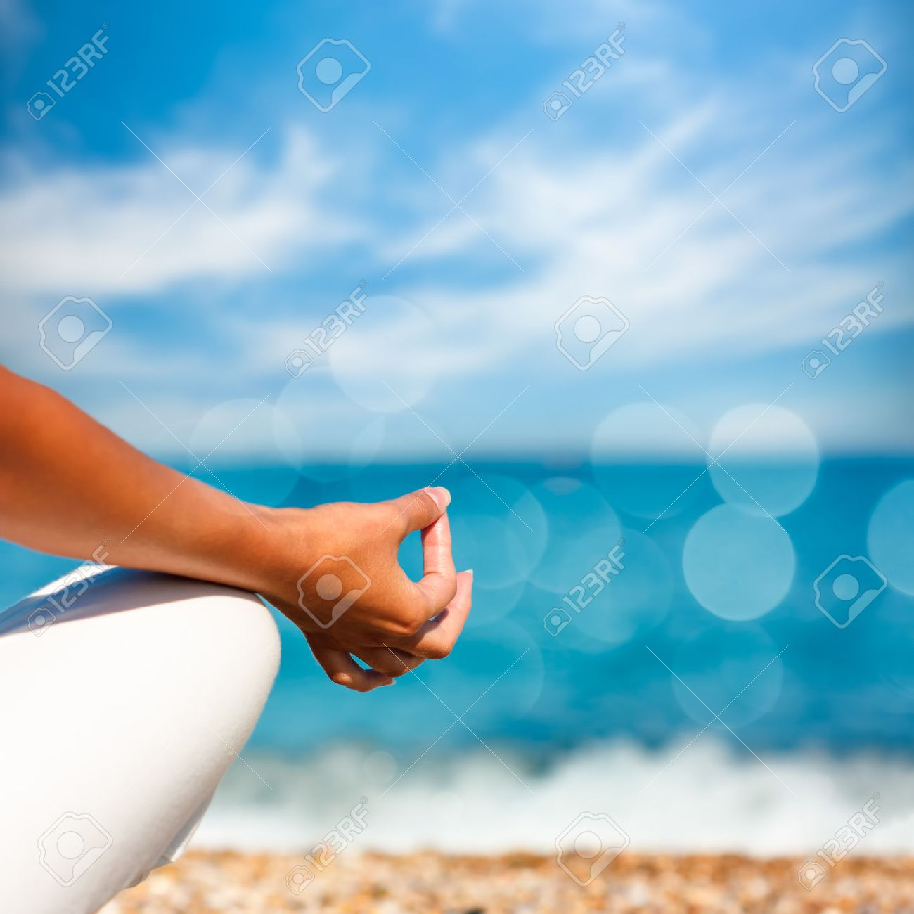 Yoga Hand on Sea Background. Healthy Lifestyle Concept. Beautiful Photo with Bokeh. Shallow Depth of Field. - 41497156