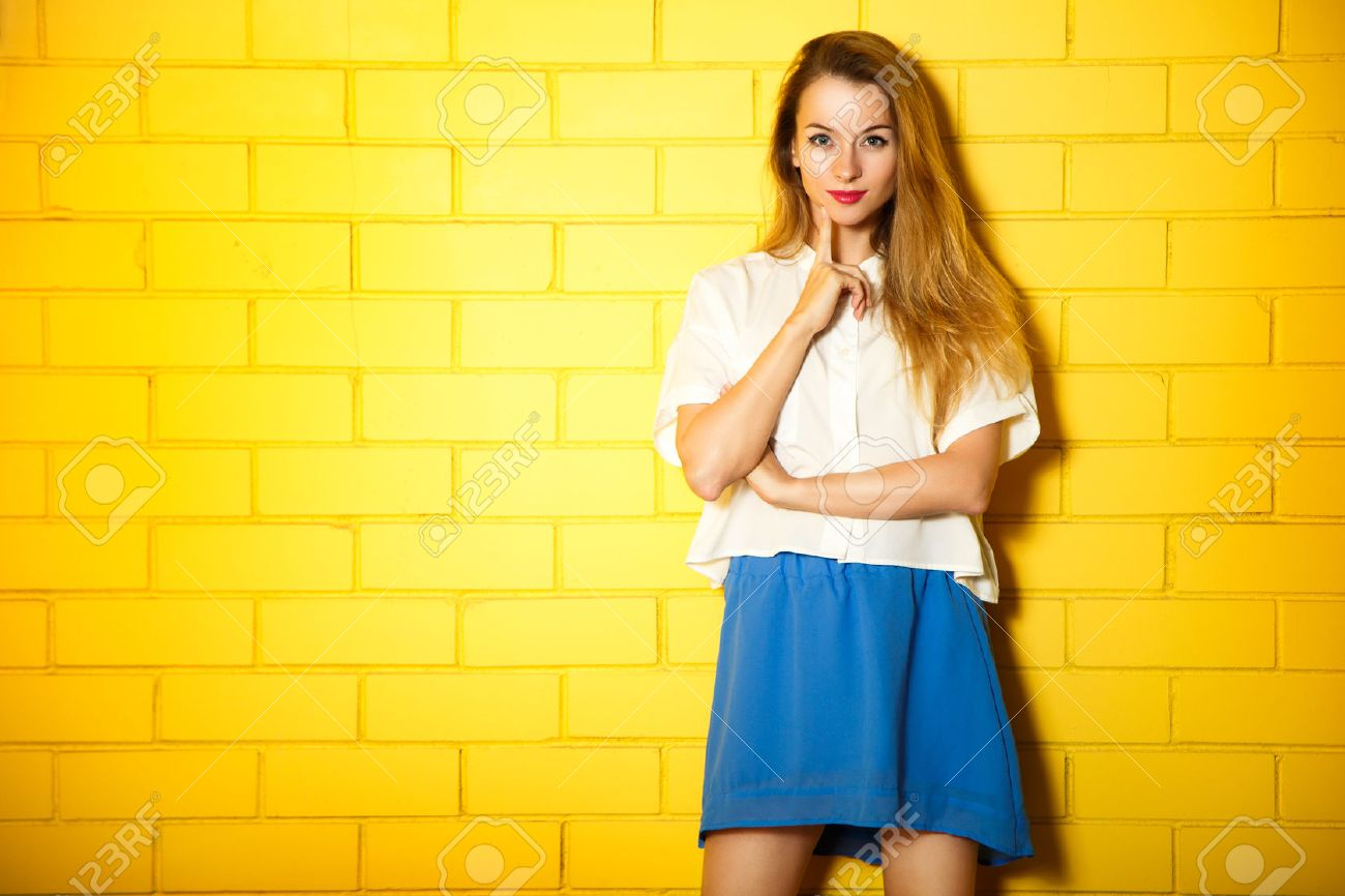 Portrait of Hipster Girl on Yellow Brick Wall Background. Urban Fashion Concept. Copy Space. - 47725461