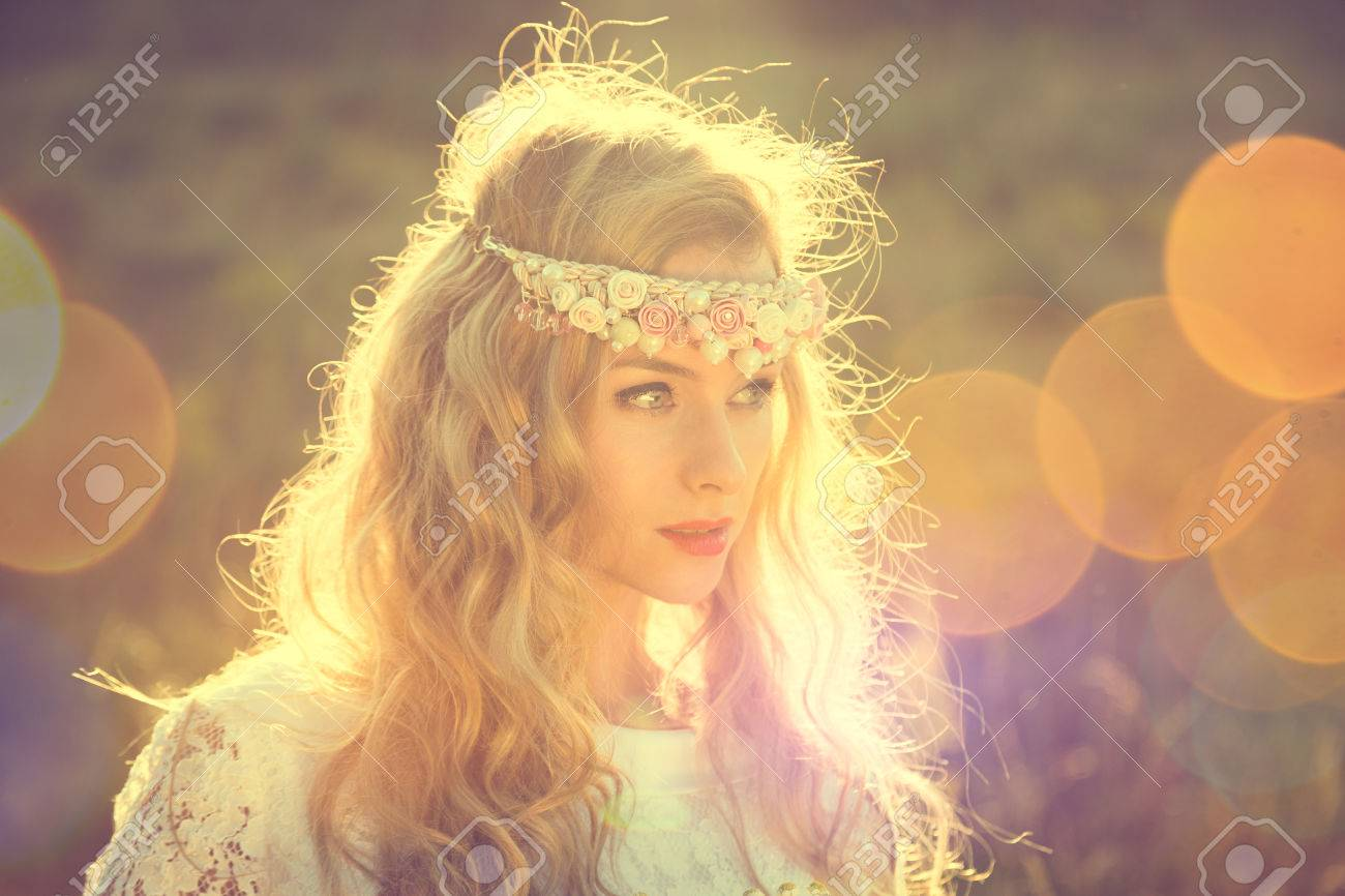 Enchanting Bride with Tiara on Nature Background. Modern Bridal Style. Boho Fashion Wedding. Filtered Cross Processed Photo with Bokeh and Copy Space. - 49543551
