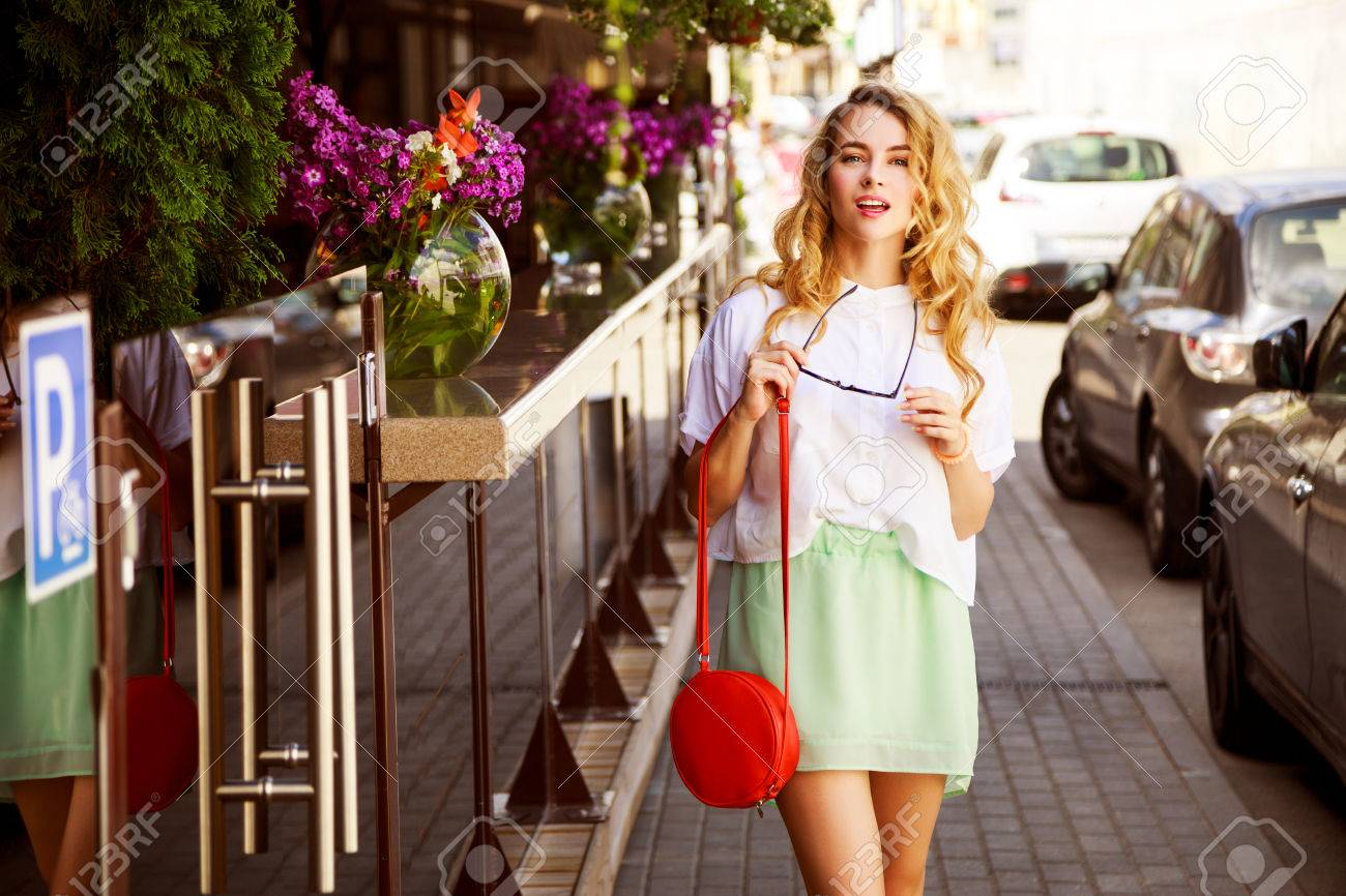 Beautiful Fashion Woman in the City Street. Trendy Girl in Summer. Toned Photo. - 63200330