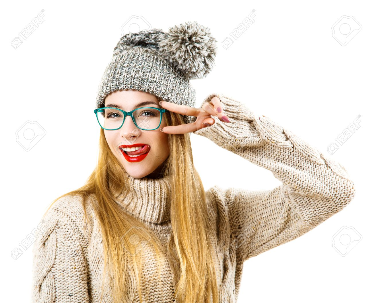 Funny Hipster Girl in Knitted Sweater and Beanie Hat Going Crazy. Isolated on White. Trendy Casual Fashion Outfit in Winter. - 62735398