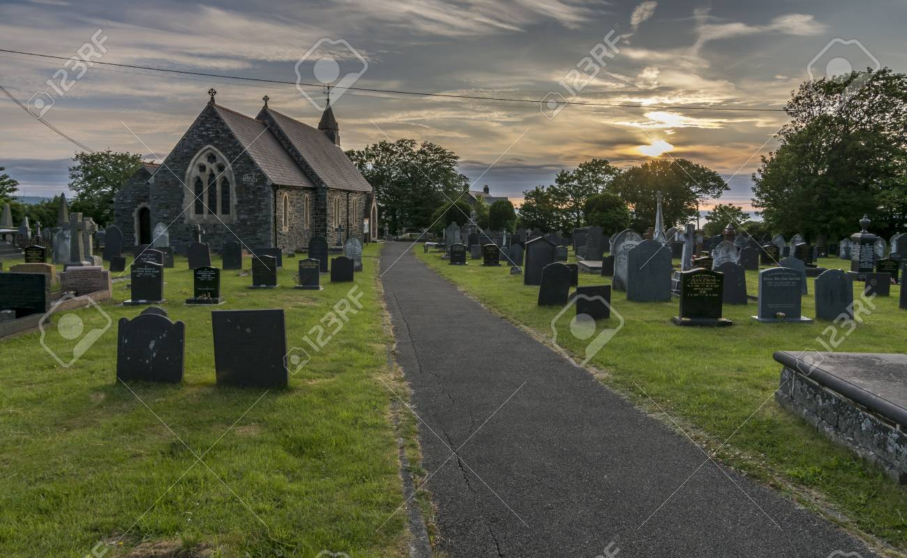 Path Leading Towards A UK Country Church At Sunset Stock Photo