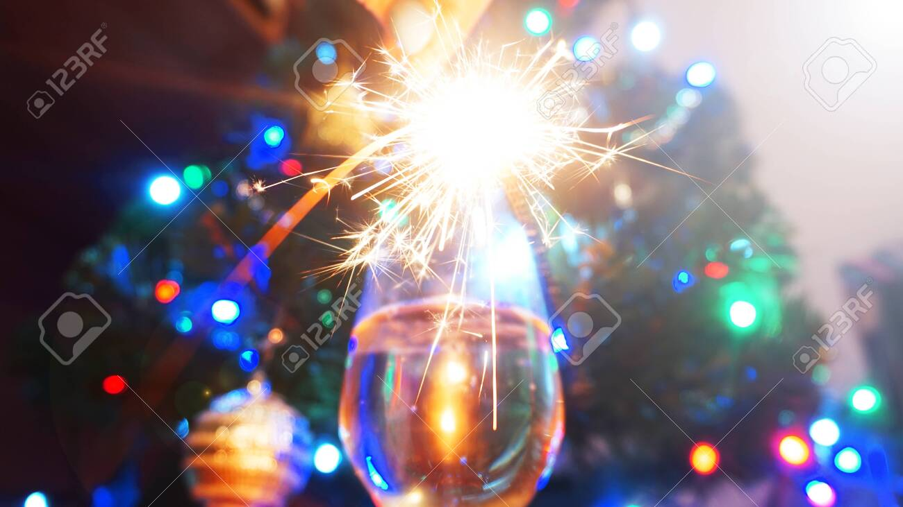 Sparkler Blurry Background Christmas Lights New Year Concept