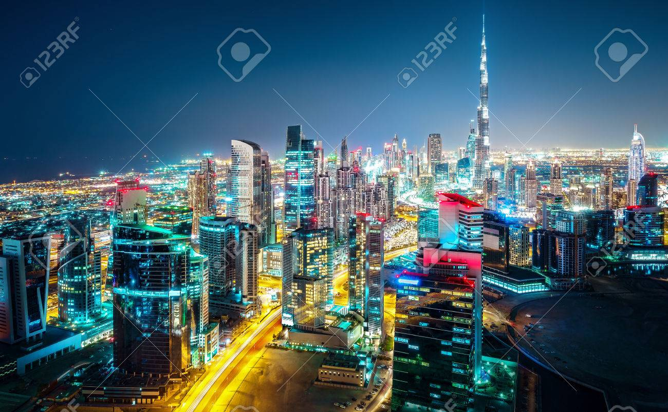 Fantastic nightime skyline of a big modern city. Downtown Dubai, United Arab Emirates. Colorful cityscape with skyscrapers. - 84037030