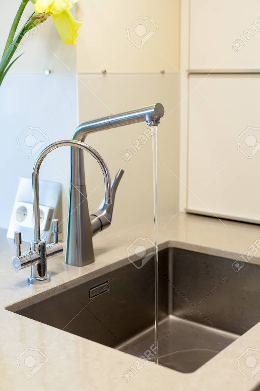 Detail Of A Rectangular Designer Kitchen Sink With Chrome Water ...