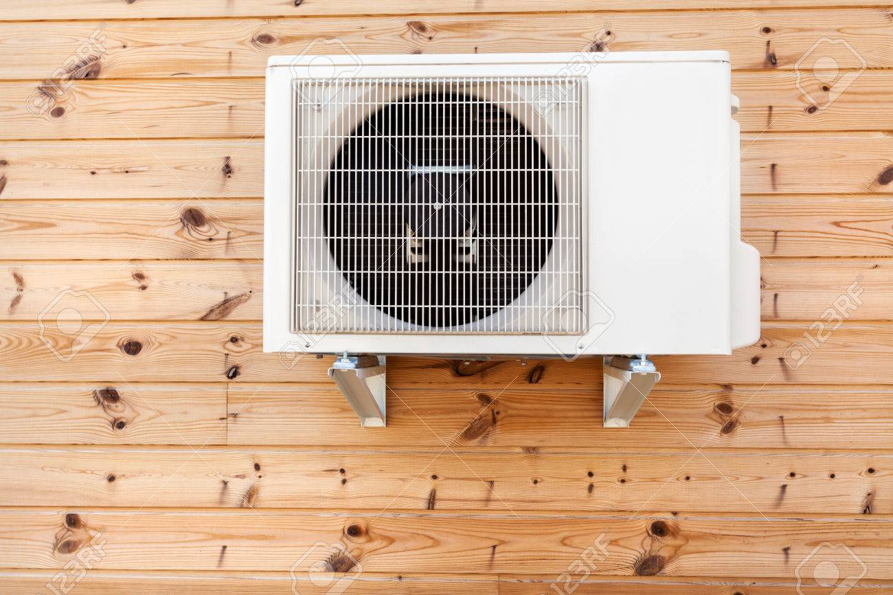 Exterior airconditioning unit on a wooden wall - 82752726