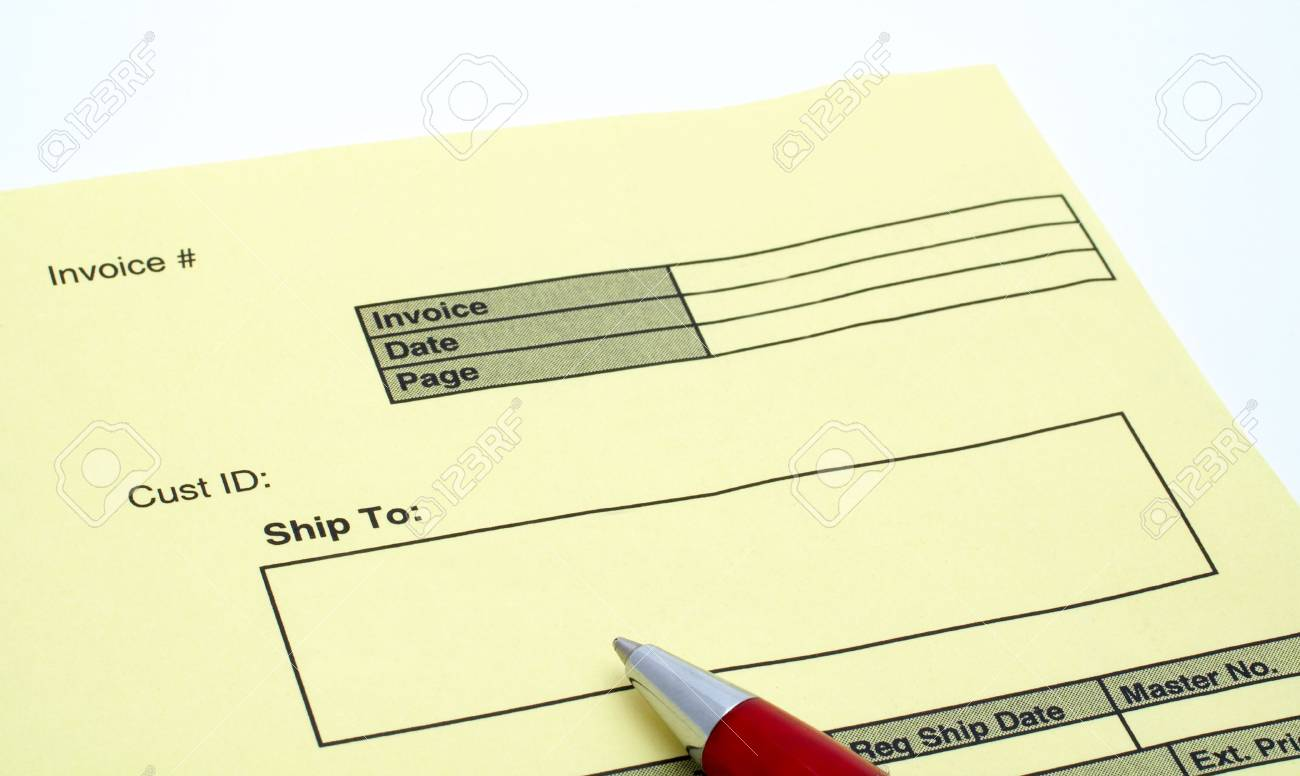 Close Up Blank Invoice With Pen On White Background Stock Photo