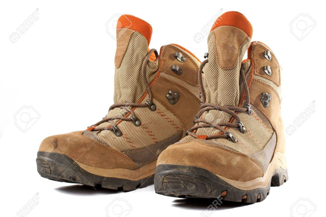 A Pair Of Used Hiking Boots Over A White Background Stock Photo ...