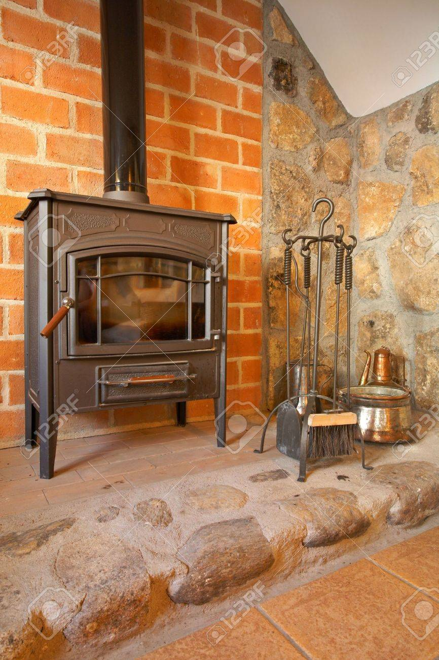 View Of A Cozy Old Fireplace In The Living Room Stock Photo