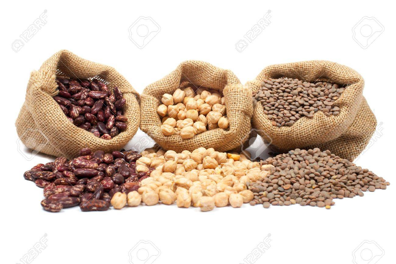 Lentils, chickpeas and red beans spilling out over a white background. Stock Photo - 1230045