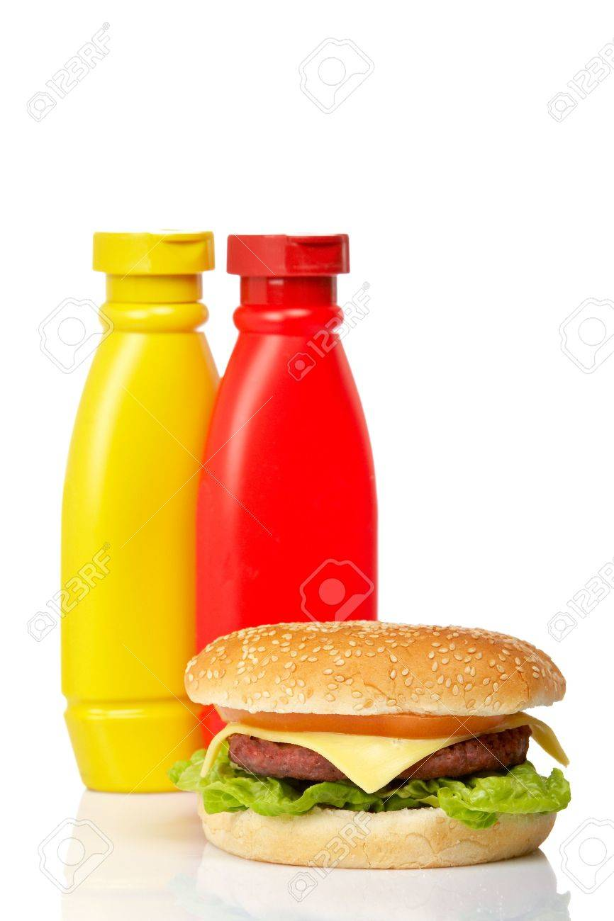 Cheeseburger with mustard and ketchup bottles, reflected on white background. Shallow DOF Stock Photo - 2268807