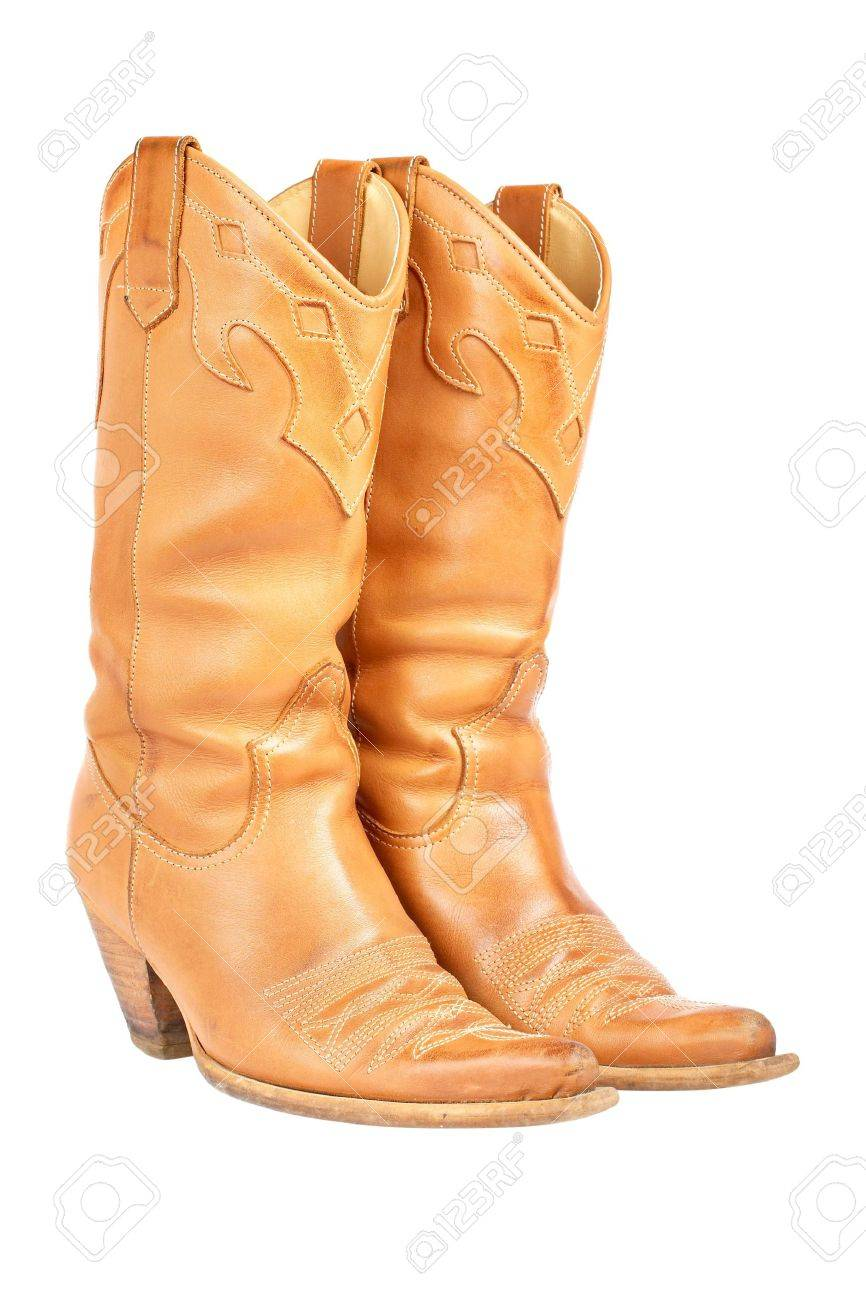A Pair Of Used Cowboy Boots Isolated On