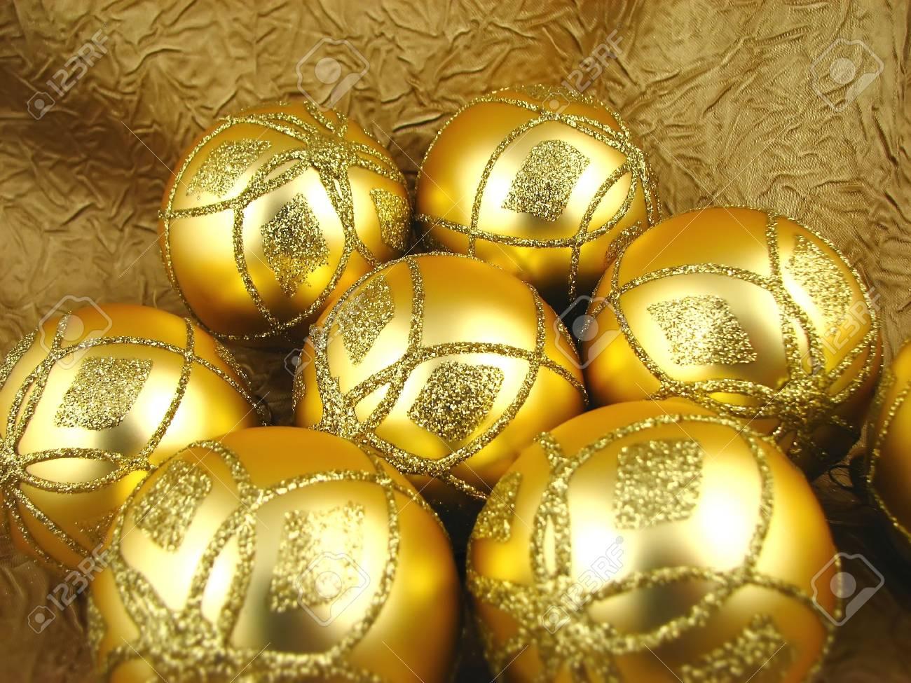 Few beautiful gold bulbs on yellow background Stock Photo - 2053947