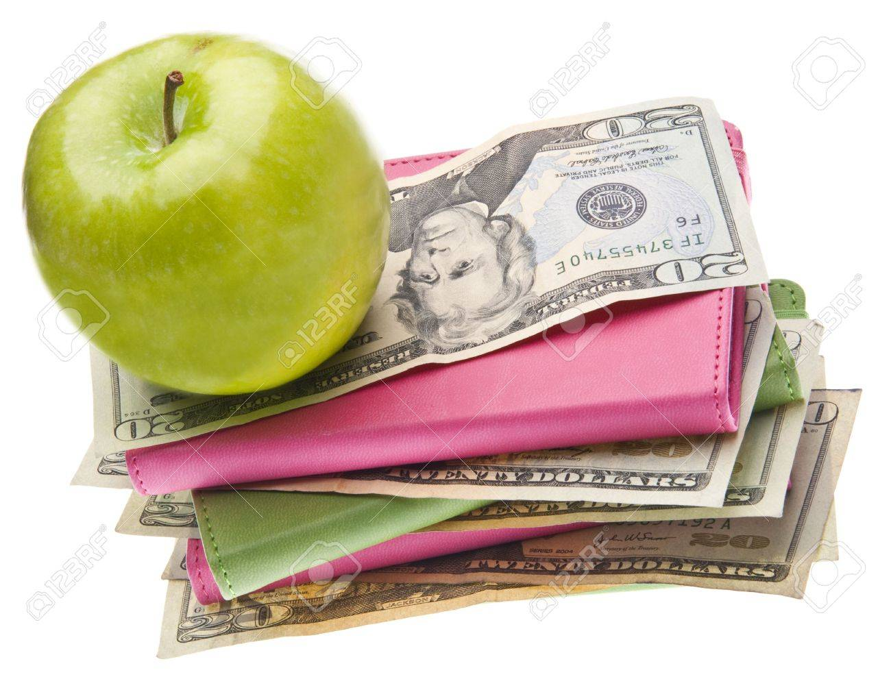 Apples, Books and Money for Health Care and Education Themed Images. Stock Photo - 6881552