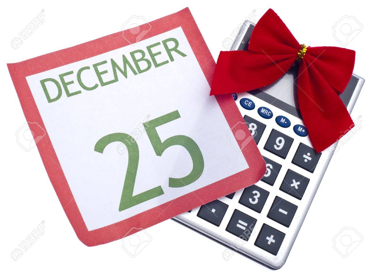 calculator with holiday bow and calendar page christmas budget
