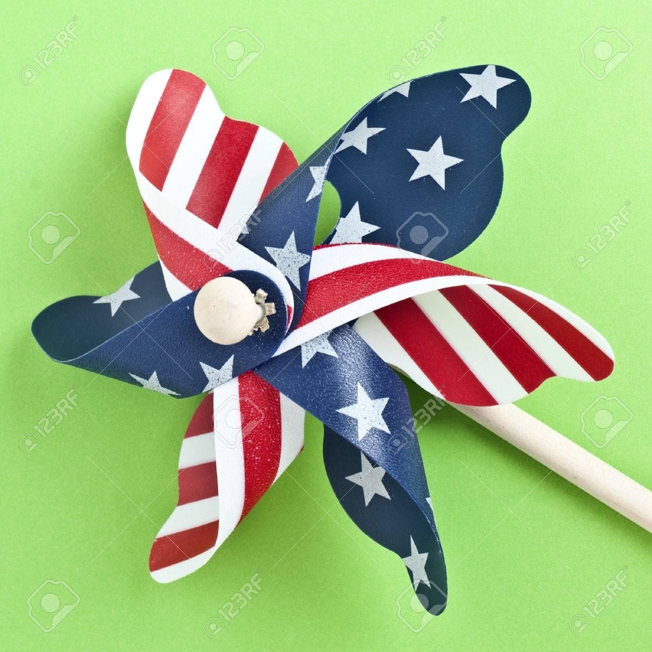 American Flag Patriotic Pinwheel on a Vibrant Green Background. Stock Photo - 8135240