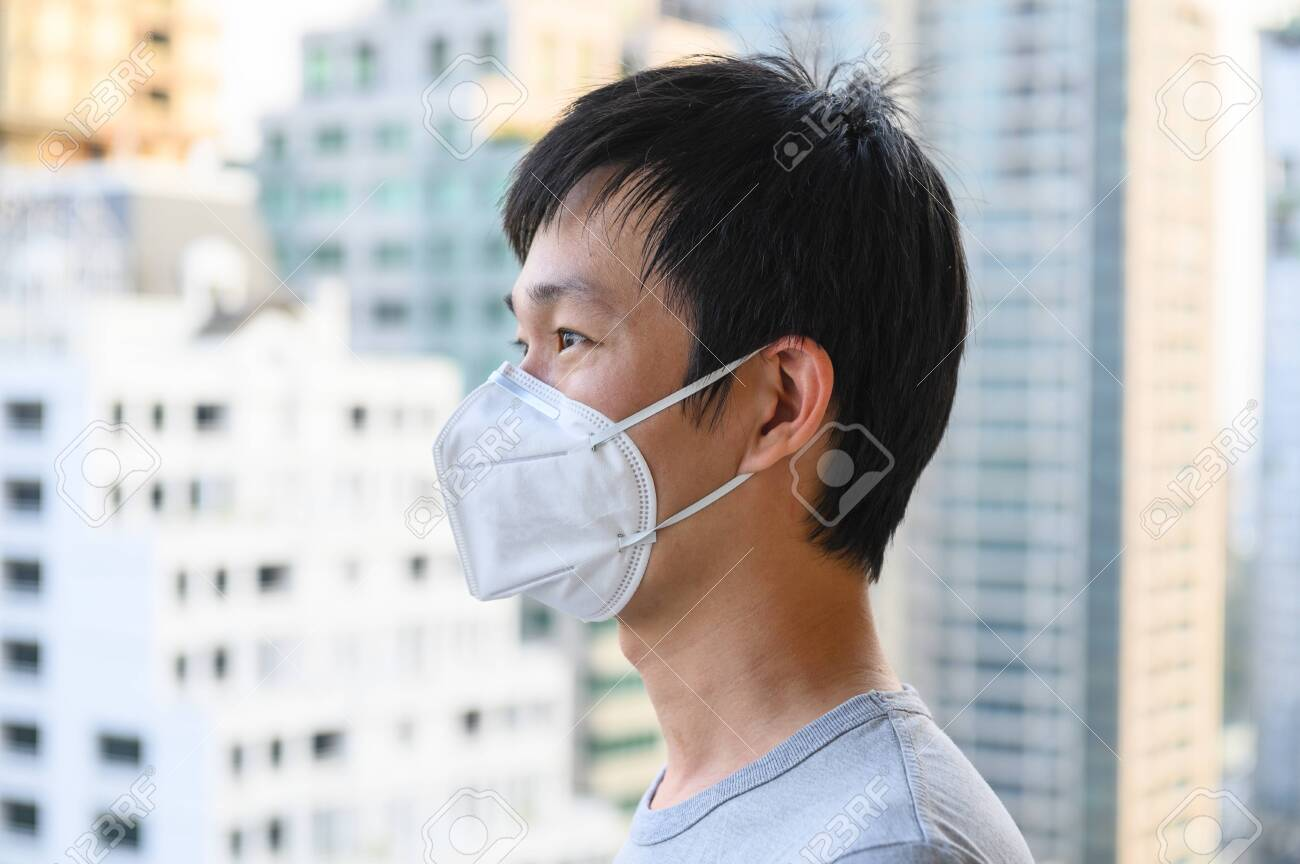Asian man wear mask for air pollution - 123794690