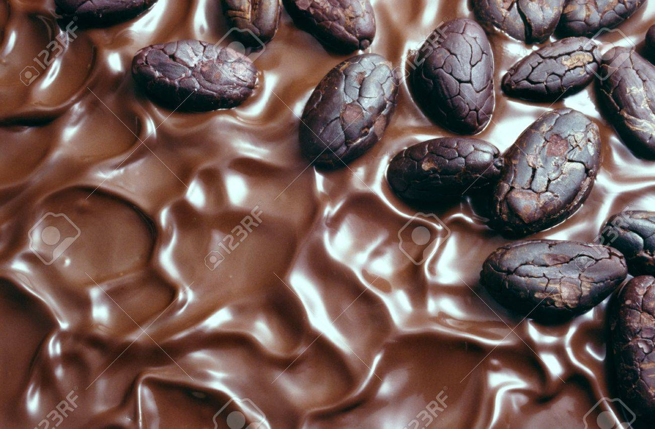 Chocolate Icing And Cocoa Beans Stock Photo, Picture And Royalty ...