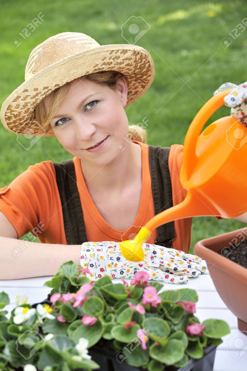 Young woman watering flowers Stock Photo - 5604405