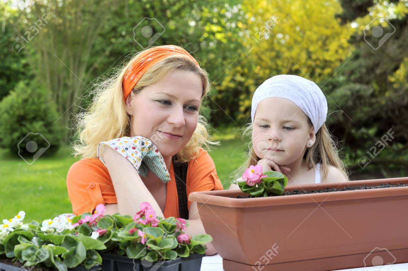 Mother and daughter having gardening time Stock Photo - 5604462