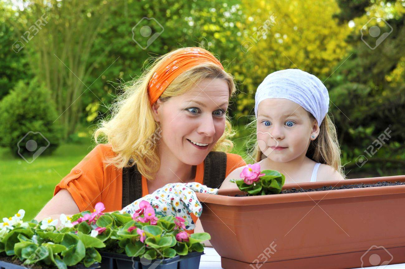 Young mother and her daughter - gardening Stock Photo - 8570977