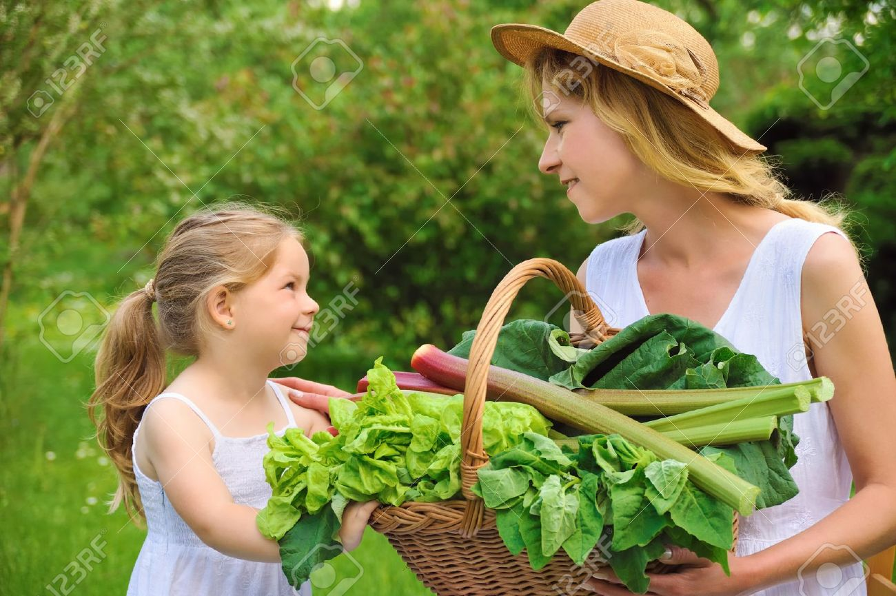 Young woman and daughter with fresh vegetable Stock Photo - 8716535